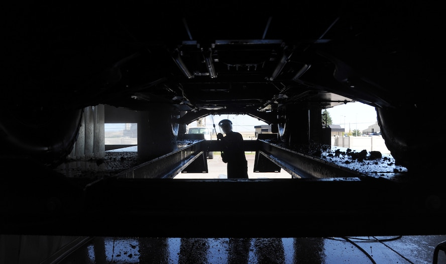 Airman 1st Class Jeremy McNeal, 341st Logistics Readiness Squadron vehicle maintenance apprentice, pressure washes a security forces Humvee July 23. Not every vehicle they receive is clean. The maintenance shop pressure washes every vehicle that comes through. (U.S. Air Force photo/Airman 1st Class Joshua Smoot)