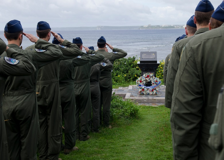 Aircrew from the 69th Expeditionary Bomb Squadron, currently deployed to Andersen from Minot Air Force Base, N.D., salute as taps is played during the annual Raider 21 memorial ceremony July 21, 2014, in Adelup, Guam. A monument was constructed at the Ricardo J. Bordallo Governor's Complex in 2009 to honor the aircrew lost off the coast of Guam during a mission in support of the 2008 Liberation Day parade. (U.S. Air Force photo by Senior Airman Katrina M. Brisbin/Released)