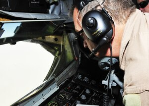 Air Force Senior Master Sgt. Floyd W. Atkins refuels a B-1B Lancer over Afghanistan, July 17, 2014. U.S. Air Force photo by Senior Airman Colin Cates