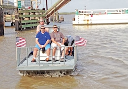 Staff Sgt. Todd Mattila, WTB, right, and Spc. Michael Pearce, WTB, left, enjoy the view as they are ferried out into inter-costal waters of Texas for their day of fishing. The two Fort Riley Soldiers participated in the Eighth Annual Sargent Tournament of Heroes fishing trip June 26 to 29 in Sargent, Texas.
