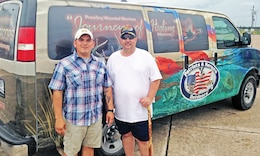 Spc. Michael Pearce, WTB, right, and Chief Warrant Officer 3 Timothy Sifuentes, WTB, left, pose for a photo during the Eighth Annual Sargent Tournament of Heroes fishing trip June 26 to 29 in Sargent, Texas.