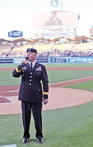 "Maj. Gen. Paul E. Funk II, 1st Infantry Division and Fort Riley commanding general, makes the traditional ""It's time for Dodger baseball"" announcement before the start of a June 30 Los Angeles Dodgers versus Cleveland Indians game at Dodgers Stadium."