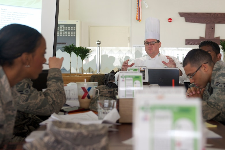 Certified Master Chef James Hanyzeski teaches a class on food preparation to Airmen from the 374th Force Support Squadron July 15, 2014, on Yokota Air Base, Japan. Hanyzeski's visit provided services Airmen with alternative healthier recipes as part of the Healthy Base Initiative. (U.S. Air Force photo/Airman 1st Class David Danford)