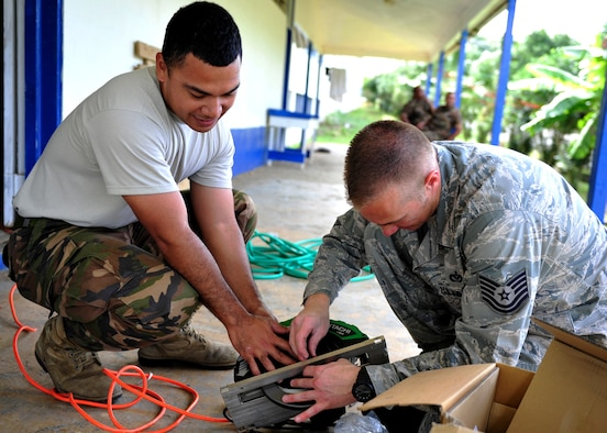 U.S. Airmen and personnel from Tonga's armed forces work together during an engineering civic action project at Mailefihi Siu'ilikutapu College, a future health services outreach site, in preparation for Pacific Angel July 14, 2014 in Vava'u, Tonga. PACANGEL is an annual regional humanitarian assistance and disaster relief operation lead by Pacific Air Forces. (U.S. Air Force photo/Capt. Cody Chiles)