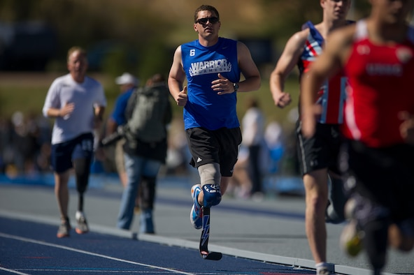 Capt. Ryan McGuire runs the 1,500-meter run and earns a gold medal at the 2012 Warrior Games held at the U.S. Air Force Academy  Colo. McGuire won a total of five medals at the 2012 Warrior Games to add to his three medals he won from the 2010 inaugural Warrior Games. McGuire is a 4th Airlift Squadron pilot. (Courtesy photo)