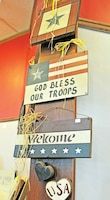 Military-themed signs hang on display ready for purchase at the Cavalry Museum.