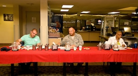 Jeffrey Moore, left, 436th Force Support Squadron bowling center manager; Lt. Col. David Kretz, center, Air Force Mortuary Affairs Operations deputy commander; and Sheila Harris, US Foods military account manager, sit at the judges table scoring the appetizer entries July 24, 2014, at the Patterson Dining Facility on Dover Air Force Base, Del. Judges also scored entrée and dessert items presented to them during the Dover Iron Chef competition. (U.S. Air Force photo/Roland Balik)
