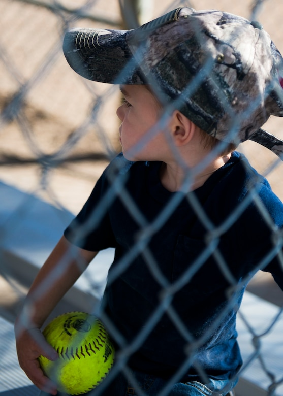 A little boy watches the Operation Warmheart softball tournament July 26, 2014, at Mountain Home Air Force Base, Idaho. The tournament lasted for three days straight to raise money for Gunfighters and their families. (U.S. Air Force photo by Airman 1st Class Malissa Lott/RELEASED)