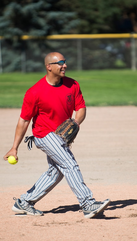 Maj. Anthony Sutton, 366th Aircraft Maintenance Squadron operations officer, pitches during the commanders versus chiefs and first sergeants opening game during the 72-hour Operation Warmheart softball tournament July 25, 2014, at Mountain Home Air Force Base, Idaho. The chiefs and first sergeants emerged victorious. (U.S. Air Force photo by Airman 1st Class Malissa Lott/RELEASED)