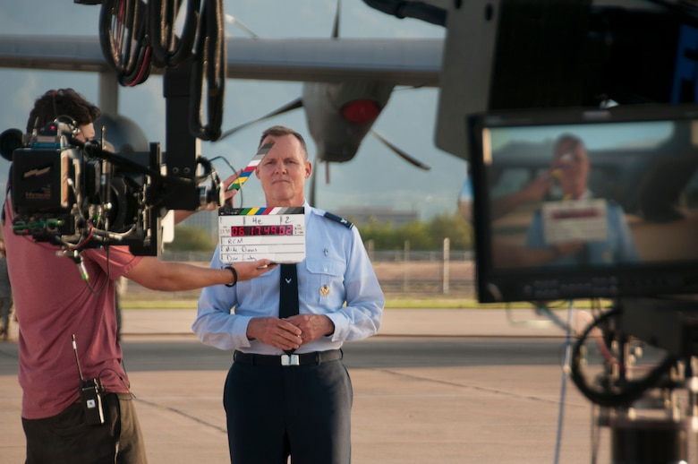 Chaplain Col. William T. Yates, deputy director of the Air National Guard Chaplain Corps, prepares for filming by the Air National Guard Recruiting Creative Marketing team at Davis-Monthan Air Force Base July 16, 2014. The team is filming a chaplain recruiting advertisement for the Air National Guard. (U.S. Air National Guard photo by Staff Sgt. Heather Davis/Released)