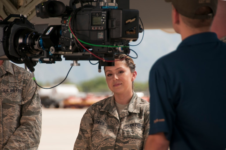 Tech Sgt. Priscilla Torres, command support staff member with the 162nd Mission Support Group, prepares for her scene during the filming of an Air National chaplain recruiting advertisement at Davis-Monthan Air Force Base July 16, 2014. The advertisement is being produced by the Air National Guard Recruiting Creative Marketing team. (U.S. Air National Guard photo by Staff Sgt. Heather Davis/Released)