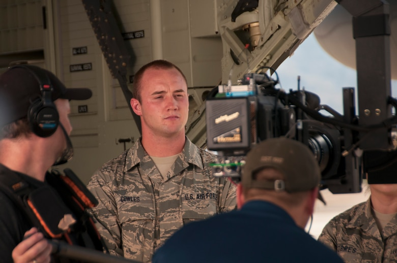 Senior Airman Curtus Cowles, equipment ordnance mechanic for the 162nd Wing, prepares for his on-camera scene during the filming of an Air National Guard chaplain recruiting advertisement at Davis-Monthan Air Force Base July 16, 2014. The advertisement is being produced by the Air National Guard Recruiting Creative Marketing team. (U.S. Air National Guard photo by Staff Sgt. Heather Davis/Released)