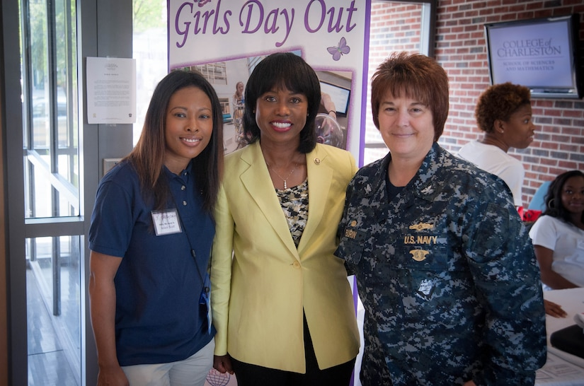 Girls Day Out Summer Camp keynote speaker, U.S. Department of Energy, Director of the Office of Economic Impact and Diversity, Honorable LaDoris Harris, poses with Space and Naval Warfare Systems Center Atlantic Girls Day Out Coordinator Anishi Scott (left), and SSC Atlantic Commanding Officer Navy Capt. Amy Burin July 26, 2014. Girls Day Out Summer Camp inspires, attracts and empowers rising 8th and 9th grade girls to pursue STEM majors and careers. (U.S. Navy photo/Joe Bullinger)