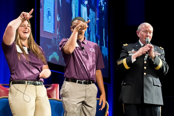 Army Gen. Martin E. Dempsey, chairman of the Joint Chiefs of Staff, sings a song at the Military Child Education Coalition's annual training seminar in Washington with six children selected for their work with the organization, July 29, 2014. The coalition works with national experts in child development, education and health to support military children. DoD photo by Navy Petty Officer 1st Class Daniel Hinton