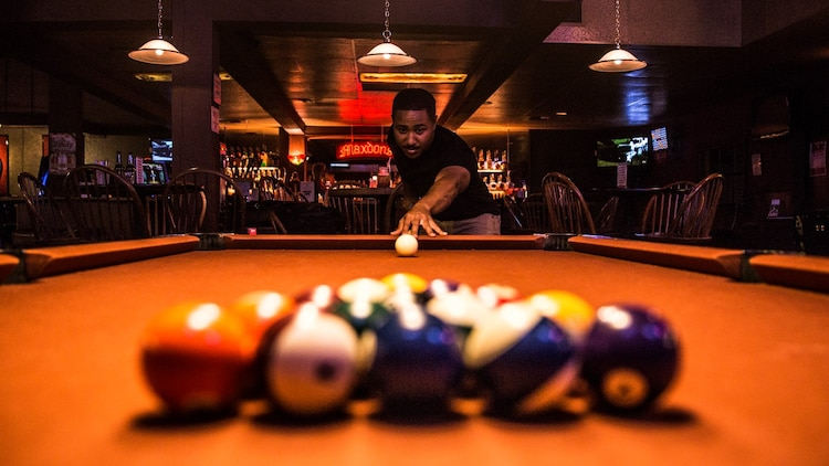 Sergeant Benjamin Eric-King Smith aims the cue ball while playing a round of billiards in Oceanside, Calif., July 22, 2014. Smith, 24, is from Wilmington, Delaware and is currently the transportation coordinator for the 15th Marine Expeditionary Unit aboard Camp Pendleton, Calif.  (U.S. Marine Corps photo by Cpl. Emmanuel Ramos/Released)