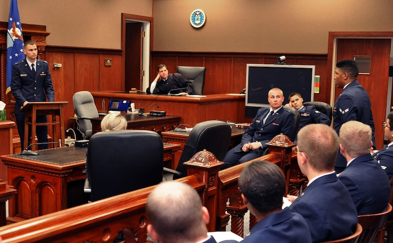 Airman 1st Class Mychal Allen (right) asks Capt. Dave Rolek questions during the first ever 'mock trial' held June 9, 2014, inside the Offutt Air Force Base Courtroom, Neb. All Airmen attending the week-long First Term Airmen's Center orientation course will participate in a mock trial as part of their training. The 55th Wing Legal Office created the program with the goal of preventing sexual assault through education and awareness. Allen is from the 55th Maintenance Squadron and Rolek is a 55th Wing assistant staff judge advocate.  (U. S. Air Force photo/Delanie Stafford)