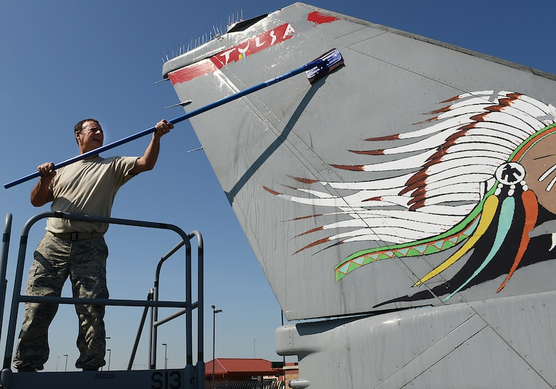 Chief Master Sergeant Brian Williams, 138th Maintenance Group Chief, scrubs the tail of an F-16 static display aircraft at the Tulsa Air National Guard base, Tulsa Okla., 29 July 2014.  Members of the 138th FW Chiefs Council gathered to wash the static aircraft in an effort to keep them looking nice for public display.  (U.S. National Guard photo by Senior Master Sgt.  Preston L. Chasteen/Released)