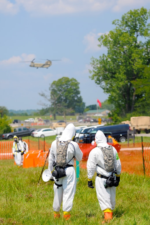 U.S. Air Force Airmen and U.S. Soldiers stand ready to help disaster victims during exercise Vibrant Response July 22, 2014 at Camp Atterbury, Ind. Vibrant Response is a major homeland emergency response exercise conducted by U.S. Northern Command which involves about 5,500 military and civilian personnel from 28 U.S. states and territories. (U.S. Air National Guard photo by Master Sgt. Ralph Branson/Released)