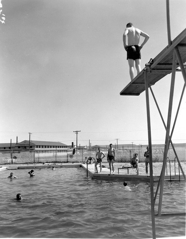 Air Guardsmen take a break from the heat at the Gowen Field base swimming pool during the summer training of June, 1954.  (Courtesy 142FW History Archives)