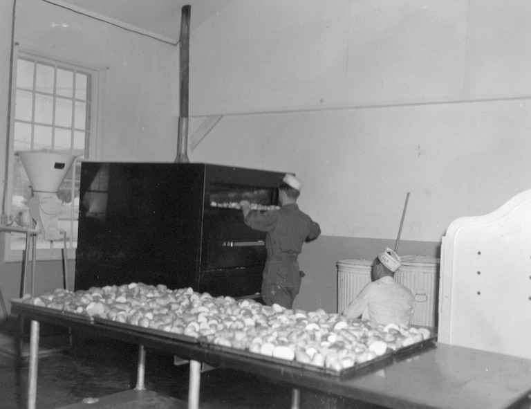 Bakers of the 142nd Food Service Squadron at work baking in preparation for a meal during annual training at Gowen Field, June 21, 1954.  (Courtesy 142FW History Archives)