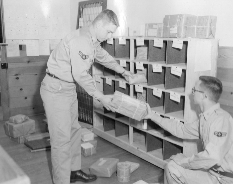 Airmen sort packages sent to OreANG Guardsmen during the annual training at Gowen Field, June 18, 1954.  Note the common use of string on the packaging.  (Courtesy 142FW History Archives)