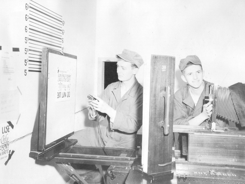 Airmen of the Photo Lab at work creating a visual information product during annual training at Gowen Field, June 18, 1954. (Courtesy 142FW History Archives)