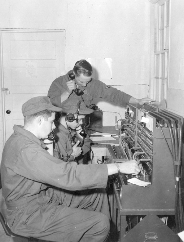 Airmen of the 142nd Communications Squadron operate a telephone switchboard during annual training at Gowen Field, June 17, 1954. (Courtesy 142FW History Archives)