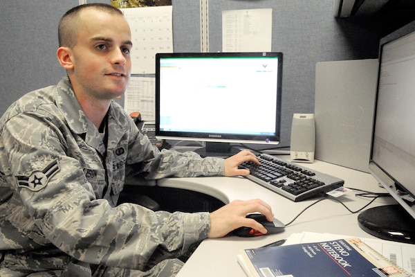AIC David Ellison is a travel pay technician with the 502nd Comptroller Squadron, Joint Base San Antonio-Lackland, Texas. (U.S. Air Force photo by Dona Fair)