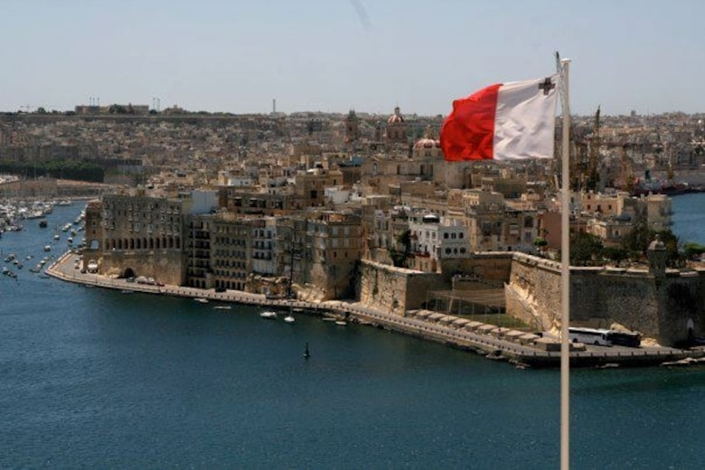 A Maltese flag flies on a clear day off the coast of Malta. The island country is a popular tourist destination located just south of Sicily. Out of all the European capitals, the capital of Malta has the warmest winters and the highest amount of sunshine per day. (Courtesy photo)