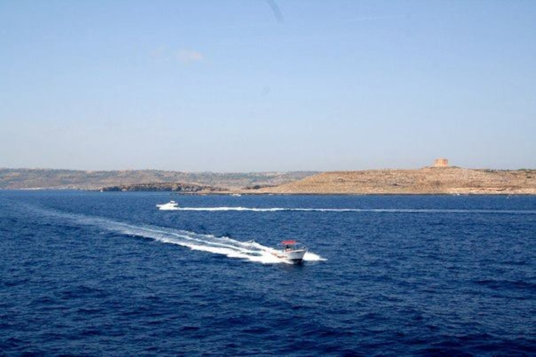 A boat crosses the waters near the island of Comino, which is where the popular Blue Lagoon is located. The Blue Lagoon is a popular day-trip for tourists who wish to escape the bustle of St. Julian's. It's also a great destination for snorkelers, divers, windsurfers and photographers. (Courtesy photo)