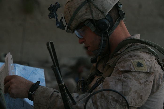 Sergeant Levi J. Slife, a joint terminal air controller, gives a class on reads a map in preparation of calling close-air support at Afghanistan 2010. The JTAC is the chief designator of artillery or close-air support ordinance and has the final say with the pilot or gunner before they commit to the attack. Slife is with Company I, Battalion Landing Team 3rd Bn., 5th Marines, 31st Marine Expeditionary Unit, and a native of Littleton, Colorado.(Courtesy photo provided by Sgt. Levi J. Slife during his second tour in Afghanistan)