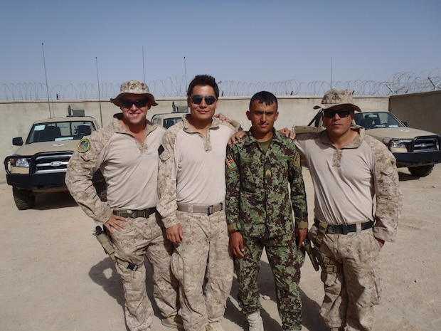 Sergeant Levi J. Slife (far left), a joint terminal air controller, poses with fellow U.S. Marines and a soldier with the Afghanistan Arm at Afghanistan 2012. The JTAC is the chief designator of artillery or close-air support ordinance and has the final say with the pilot or gunner before they commit to the attack. Slife is with Company I, Battalion Landing Team 3rd Bn., 5th Marines, 31st Marine Expeditionary Unit, and a native of Littleton, Colorado. (Courtesy photo provided by Sgt. Levi J. Slife during his third tour in Afghanistan.)