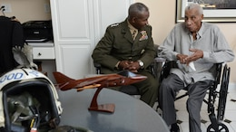Lt. Gen. Frank E. Petersen, Jr. (ret), right, converses with Lt. Gen. Ronald Bailey, the deputy commandant for plans, policies, and operations with Headquarters Marine Corps during a home visit where he was presented with a Congressional Record statement at his home in Stevensville, Maryland, July 28.