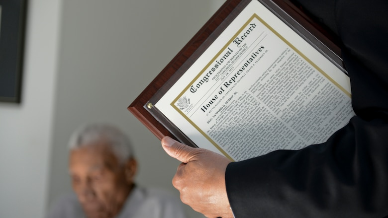 A Congressional Record statement was presented to Lt. Gen. Frank E. Petersen, Jr. (ret.) by U.S. Rep. Sanford D. Bishop, Jr., honoring his significant accomplishments throughout his military career at his home in Stevensville, Maryland July 28.