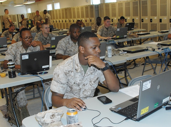 Marine reservists familiarize themselves with the Global Combat Support System-Marine Corps, July 24, during their annual training at Marine Corps Logistics Base Albany, Georgia. The GCSS-MC is a system that ensures proper logistical receipt, disbursement and tracking of equipment.