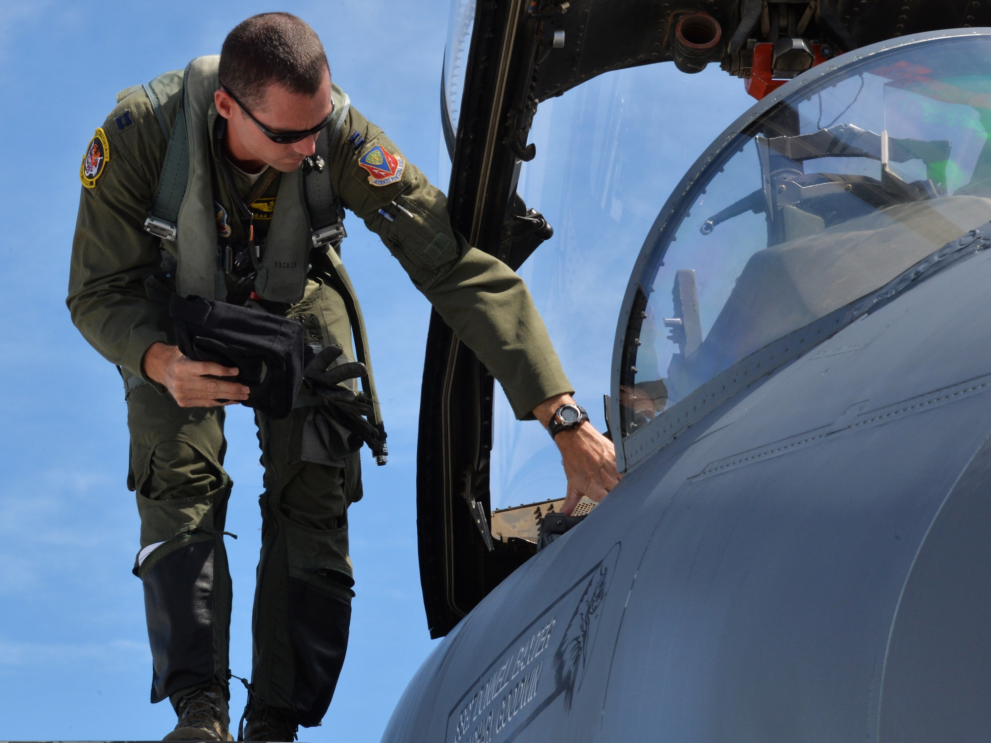Capt. Patrick Hickie III prepares to enter an aircraft during a mission July 16, 2014, at Joint Base Pearl Harbor-Hickam, Hawaii. The 391st Fighter Squadron is currently on a two-month deployment here from Mountain Home Air Force Base, Idaho. While here, the squadron's F-15E Strike Eagles have participated in Rim of the Pacific 2014 exercise missions. RIMPAC is a U.S. Pacific Command-hosted biennial multinational maritime exercise designed to foster and sustain international cooperation on the security of the world's oceans. Hickie is a 391st FS F-15E weapon systems officer. (U.S. Air Force photo/Staff Sgt. Alexander Martinez)