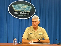 WASHINGTON (July 29, 2014) - Navy Adm. Samuel J. Locklear III, commander of U.S. Pacific Command, listens to a reporter's question during a news conference at the Pentagon.