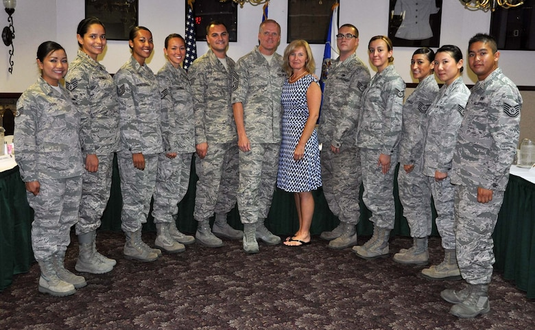 Chief Master Sgt of the Air Force James A. Cody, and his wife, Athena, posed for a photo following breakfast with selected, outstanding Airmen who represented a cross-selection of the March Total Force. CMSAF Cody and Athena visited March Air Reserve Base in Southern California July 11-14, 2014, where they met with Airmen and observed the success of Total Force Integration there. (U.S. Air Force photo/Master Sgt. Linda Welz)