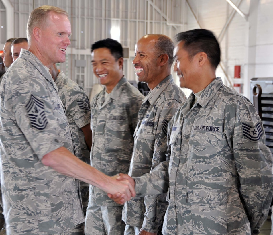Chief Master Sgt of the Air Force James A. Cody, meets and greets Airmen during a July 11-14, 2014 visit to March Air Reserve Base. While there, CMSAF Cody and his wife, Athena, met with Airmen and observed the success of Total Force Integration. (U.S. Air Force photo/Master Sgt. Linda Welz)