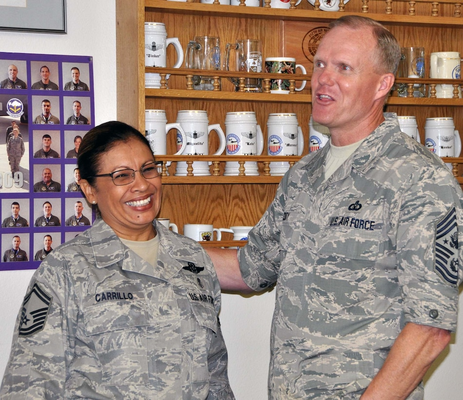 Chief Master Sgt of the Air Force James A. Cody presented his coin to Senior Master Sgt. Josephine Carrillo for her outstanding work as the Yellow Ribbon program manager. CMSAF Cody and Athena visited March Air Reserve Base in Southern California July 11-14, 2014, where they met with Airmen and observed the success of Total Force Integration there. (U.S. Air Force photo/Master Sgt. Linda Welz)