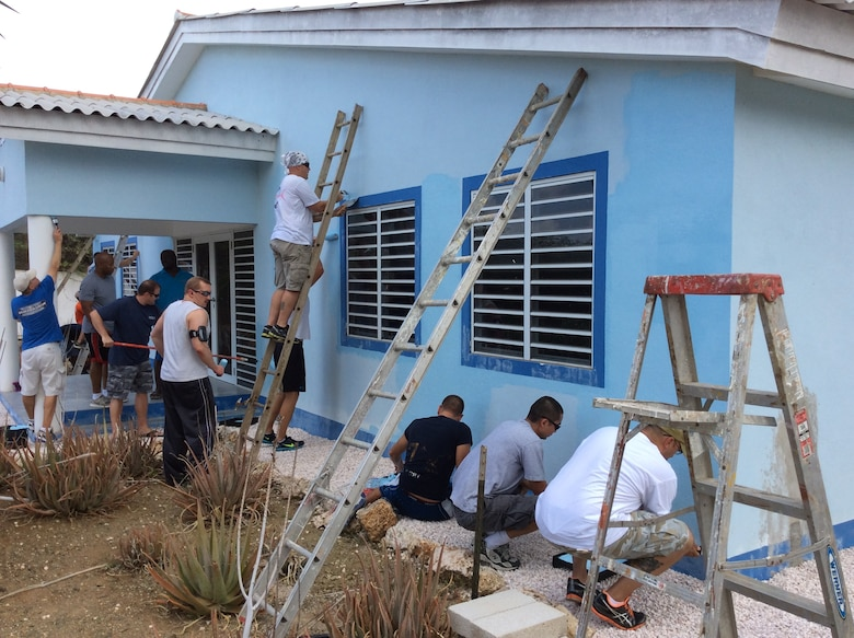 Twenty volunteers from the U.S. Forward Operating Location painted the Siloam Orphanage facility in Curaçao, July 29, 2014.  The volunteers painted the exterior of the building and donated clothing, hygiene products, recreational toys and funds to increase the children's quality of life.  This project was completed in partnership with the director, Bro Herman, to ensure that the children's needs were met, including a safe and secure environment. The men and women at the USFOL are frequent volunteers in the local community, to express appreciation for the two countries' friendship and the wonderful hospitality they have received from the people of Curaçao.  (Courtesy Photo)