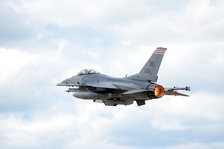 An F-16 Fighting Falcon from the 115th Fighter Wing in Madison, Wis., takes off above Volk Field Air National Guard Base, Wis., July 16, 2014. The jets were moved to Volk Field for the month of July, while the Dane County Regional Airport completed runway maintenance and repairs. (Air National Guard photo by Senior Airman Andrea F. Liechti)