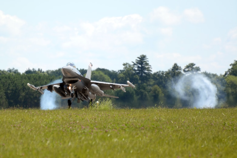 An F-16 Fighting Falcon from the 115th Fighter Wing in Madison, Wis., lands on the runway at Volk Field Air National Guard Base, Wis., July 16, 2014. The jets were moved to Volk Field for the month of July, while the Dane County Regional Airport completed runway maintenance and repairs. (Air National Guard photo by Senior Airman Andrea F. Liechti)