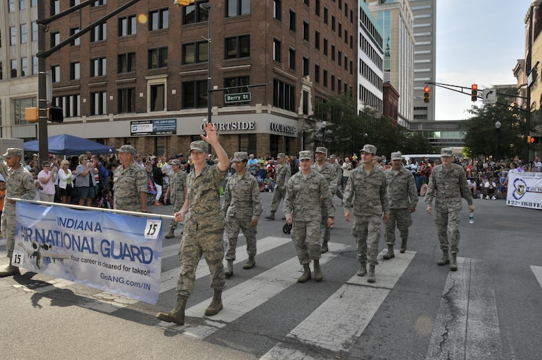 Members from the 122nd Fighter Wing, Fort Wayne, Indiana participate in the 46th Annual Three Rivers Festival Parade, July 12, 2014, held on the streets of downtown Fort Wayne. The yearly parade, attended by approximately 50,000 people, allows the wing to show its community support. (Air National Guard photo by Airman 1st Class Justin Andras/Released)