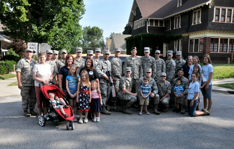 Members and volunteers from the 122nd Fighter Wing, Fort Wayne, Indiana pose for a group photo during the 46th Annual Three Rivers Festival Parade, July 12, 2014, held on the streets of downtown Fort Wayne. The yearly parade, attended by approximately 50,000 people, allows the wing to show its community support. (Air National Guard photo by Airman 1st Class Justin Andras/Released)