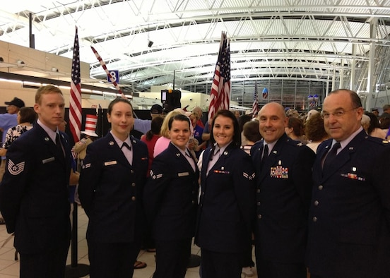 Members from the Illinois Air National Guard's 126th Air Refueling Wing stand at Lambert International Airport, St. Louis, Mo., July 8, 2014, after greeting veterans during the Greater St. Louis Area Honor Flight. (Courtesy  photo)