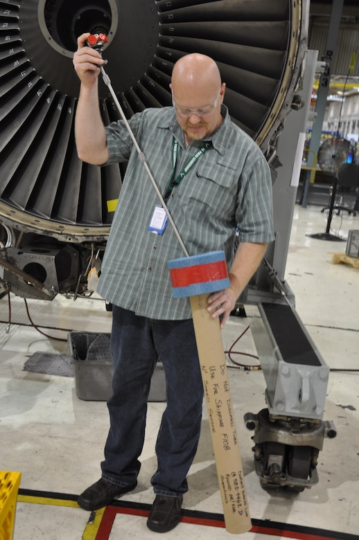 Curtis Vincent, 546th Propulsion Maintenance Squadron, showing new constructed Speed Sensor transportation container.