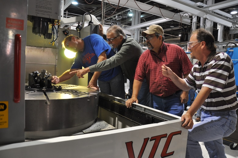 The 76th Propulsion Maintenance Group QP Repair Development team — Chuck Brown, mechanic; Reid Smith, Pratt & Whitney engineer; Larry Quintanilla, industrial engineering technician; and Kevin Altsman, lead engineer — addresses F119 fixture issues.