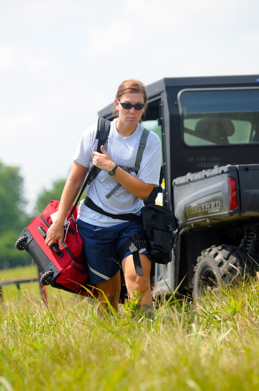 U.S. Air Force Tech. Sgt. Jennifer Krystek carries equipment during Joint Exercise Vibrant Response July 22, 2014 at Camp Atterbury, Ind. Sgt. Krystek is a member of the 121st Air Refueling Wing Force Support Squadron assigned to the Fatality Search and Recovery team. (U.S. Air National Guard photo by Master Sgt. Ralph Branson)