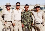 Marine Corps Sgt. Levi J. Slife, far left, a joint terminal air controller, poses with fellow U.S. Marines and an Afghan soldier in Afghanistan in 2012. Courtesy photo